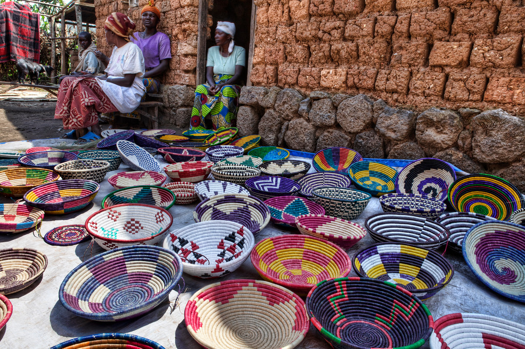 Village women near Gisenyi, Rwanda with their colorful baskets made of dried dyed grass.
