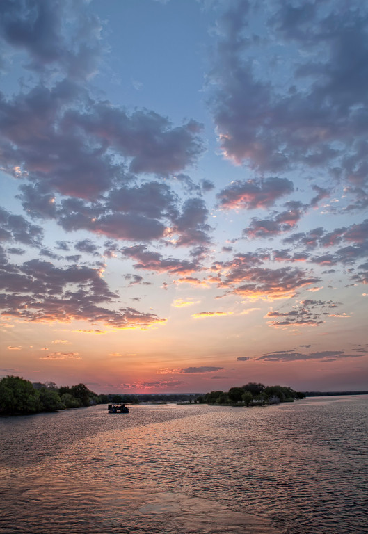 Spectacular sunset over the Upper Zambezi river in Zambia.