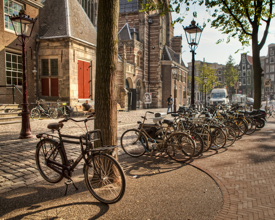 Bicycles near the old church in the red light district in Amsterdam