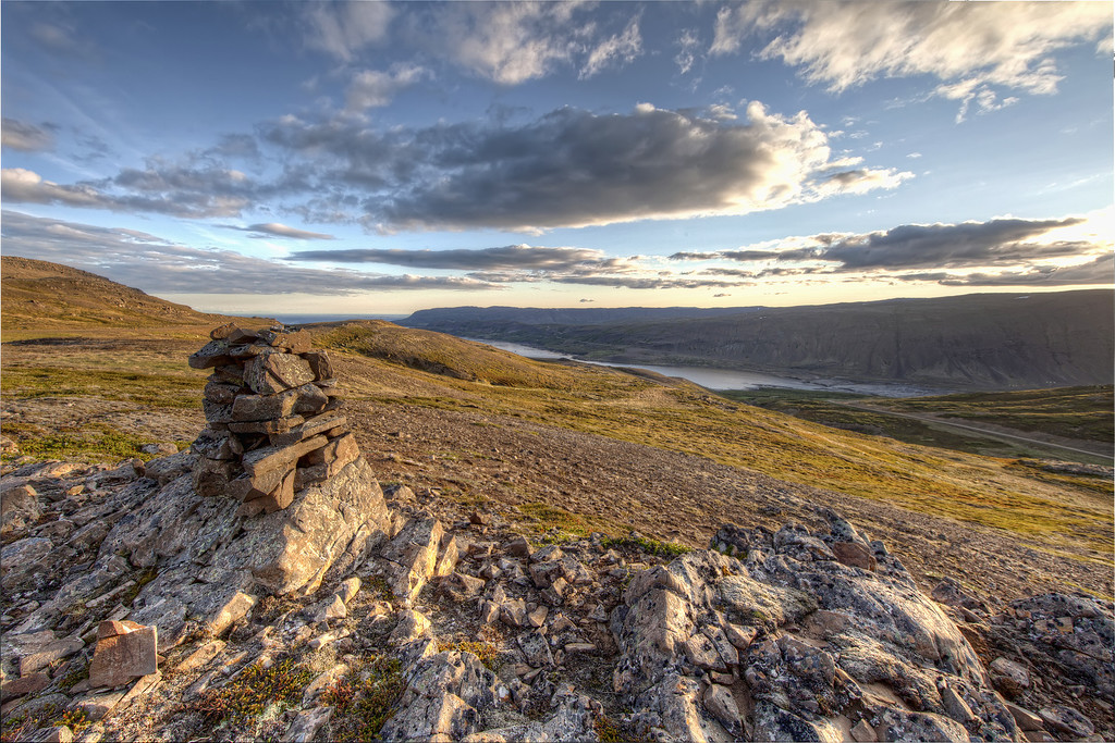 Rock pile in remote area with expansive view of water and sky in Westfjords, Iceland