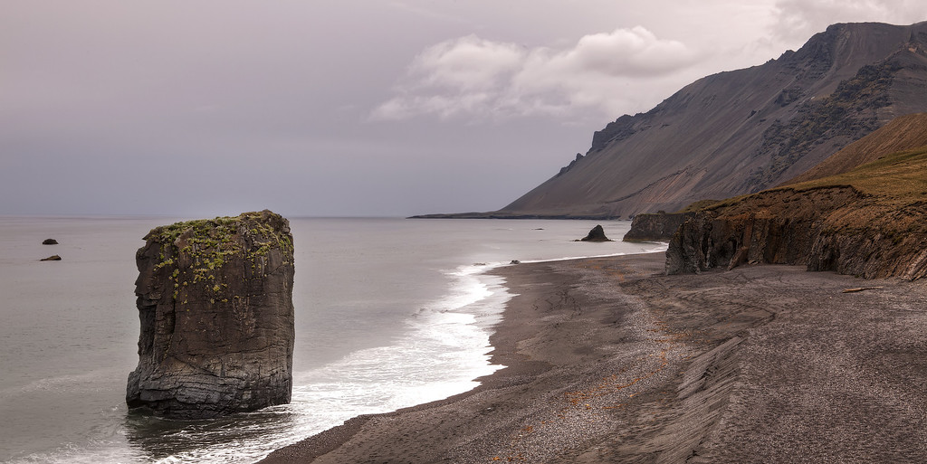 A petrified troll, rock column, on the rugged southern coast of iceland