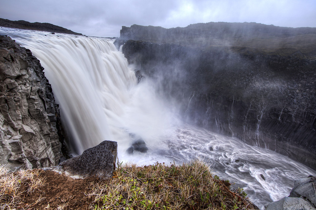 Detifoss, the most powerful waterfall in Iceland, taken from the edge showing a torrent of water.