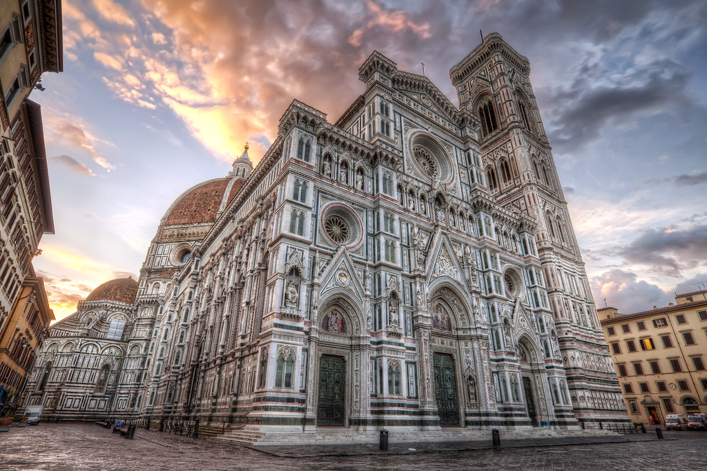 ll Duomo in Florence, Italy viewed from below in front of sunrise sky