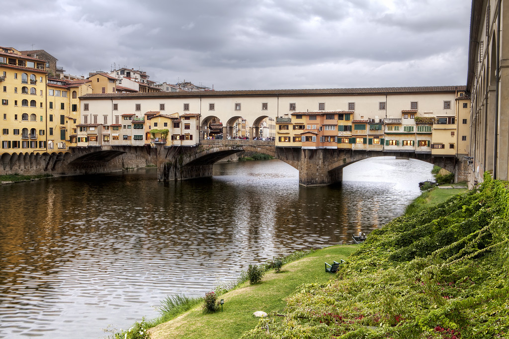 the ponte vecchio in Florence, Italy under a gloomy grey sky