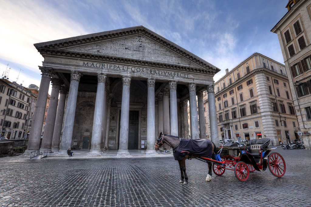 A horse and buggy parked next to the Pantheon in Rome
