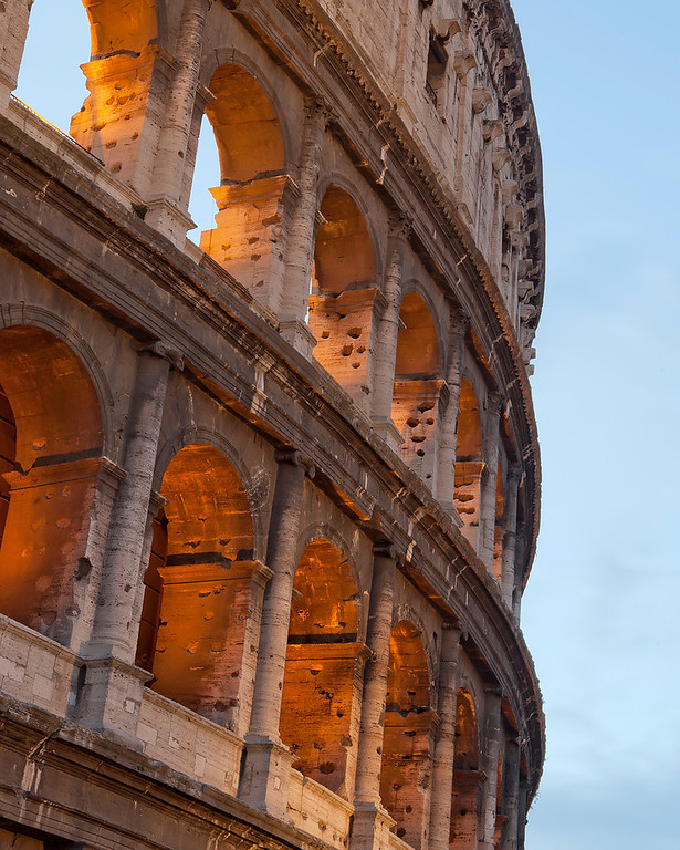 the-roman-colloseum-up-close-in-the-evening-arches-lit