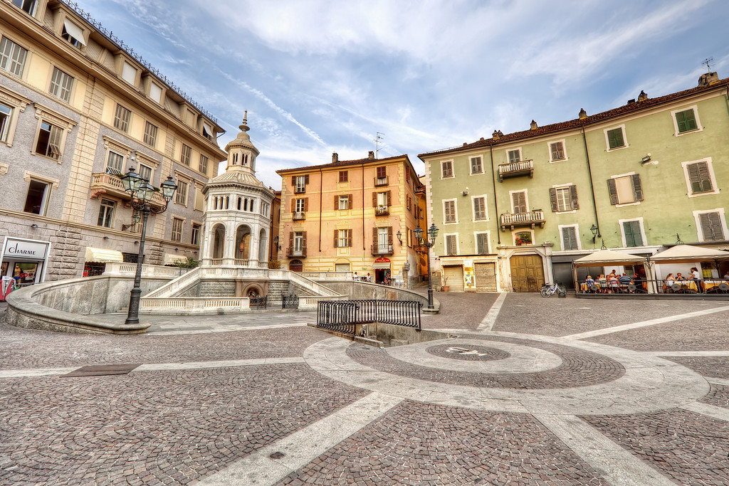 The Roman Spring at Acqui Terme, in a typical Italian square under a blue sky in piedmont, italy