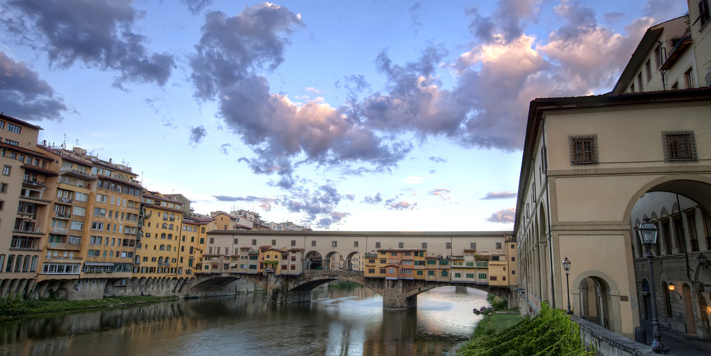 ponte vecchio in florence on a beautiful cotton candy cloud morning