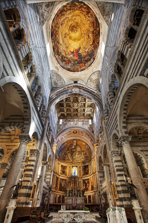 Wide angle view of the interior of the Sienna Cathedral in Tuscany showing the altar and ceiling