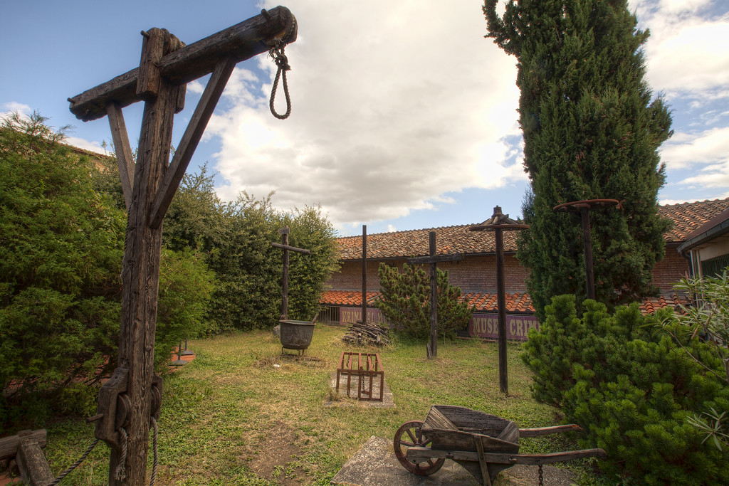 the central courtyard of the torture museum in san Gimignano tuscany italy