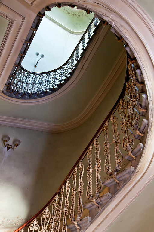 Ornate brass staircase in building in Florence, Italy