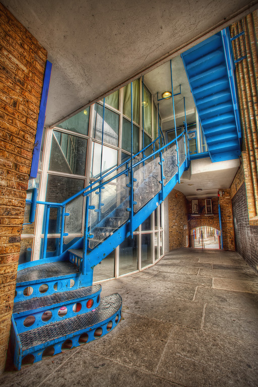 Blue staircase surrounded by brickwork