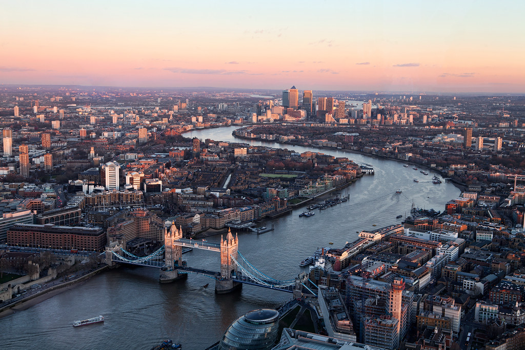 the thames forms an s shape as it winds under tower bridge towards canary wharf view from the shard London