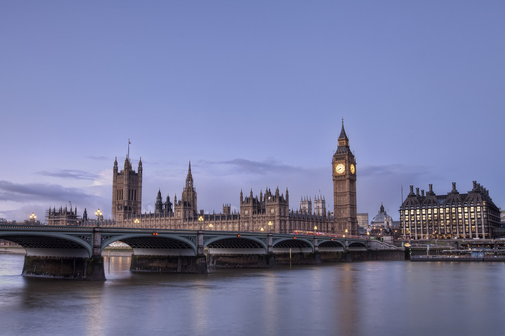 westminster housesof parliament and big ben early morning from across the calm thames in London