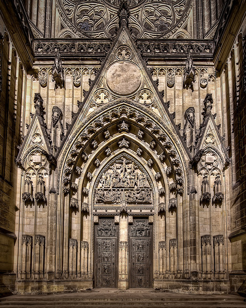 Grandeur of St. Vitus Cathedral's original doors in Prague