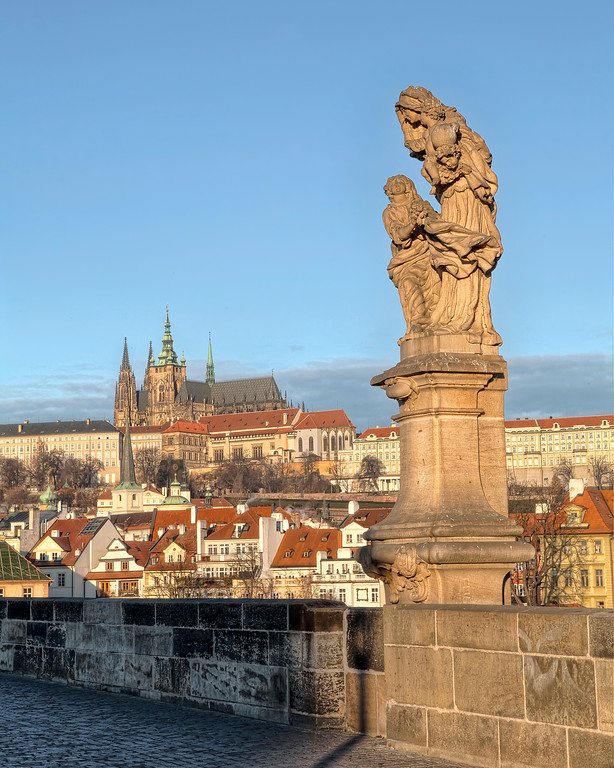 Statue of St. Vitus on the Charles Bridge looking over the old town of Prague.