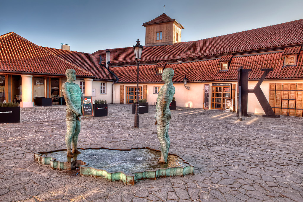 Animated statues of men urinating in the courtyard Franz Kafka Museum in Prague