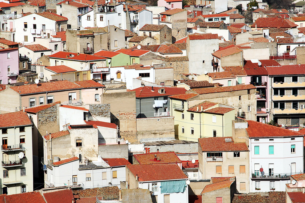 tightly packed rooftops in sardinia, italy