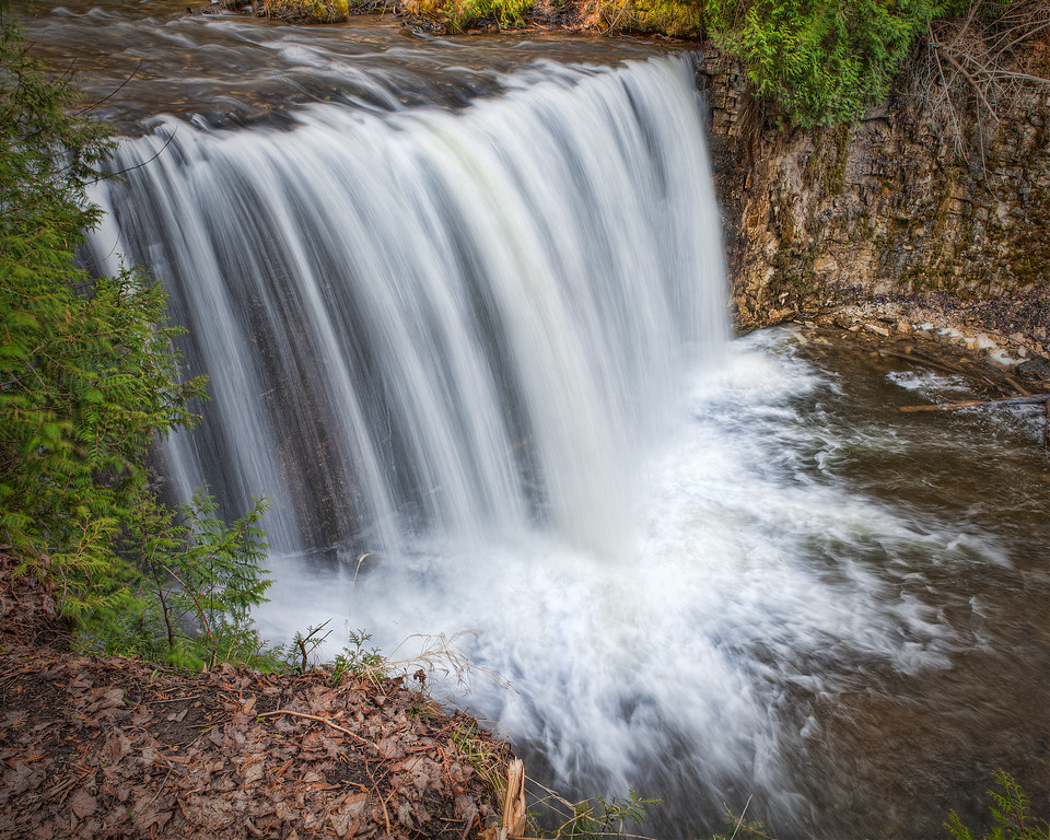 Hoggs Falls waterfall with a wide curtain of water in Ontario, Canada.