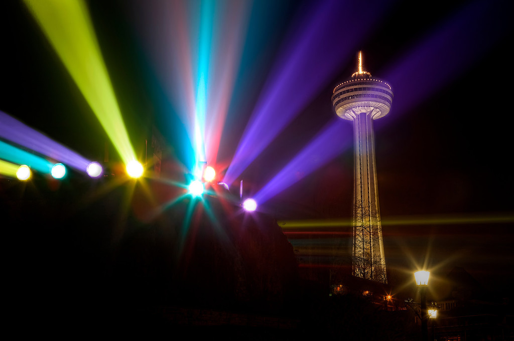 Colored spot lights reflected in the rain at Niagara Falls and lighting up the Skylon