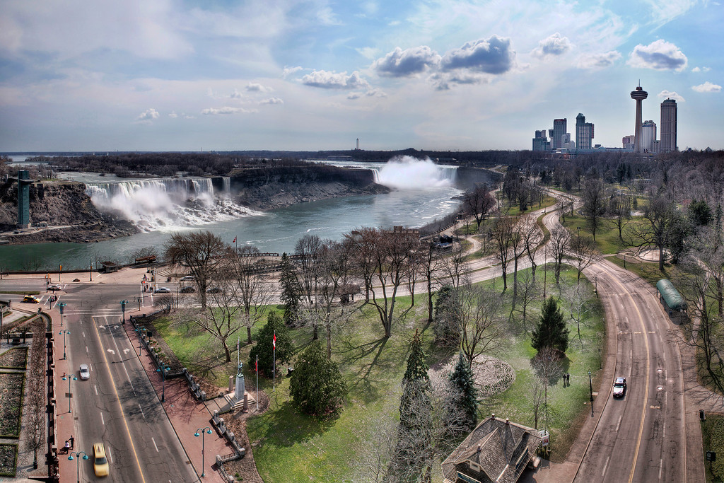 Cityscape panorama of Niagara Falls in Canada taken above and showing surrounding roads.