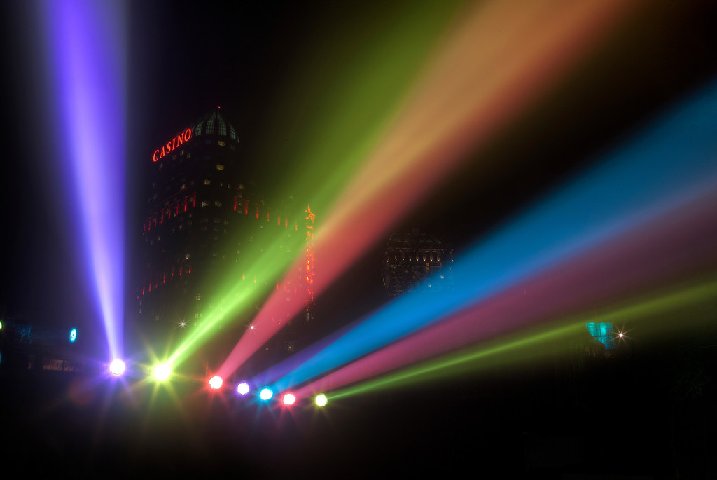 Multicolor spotlights in front of the casino at night in Niagara, Ontario, Canada.