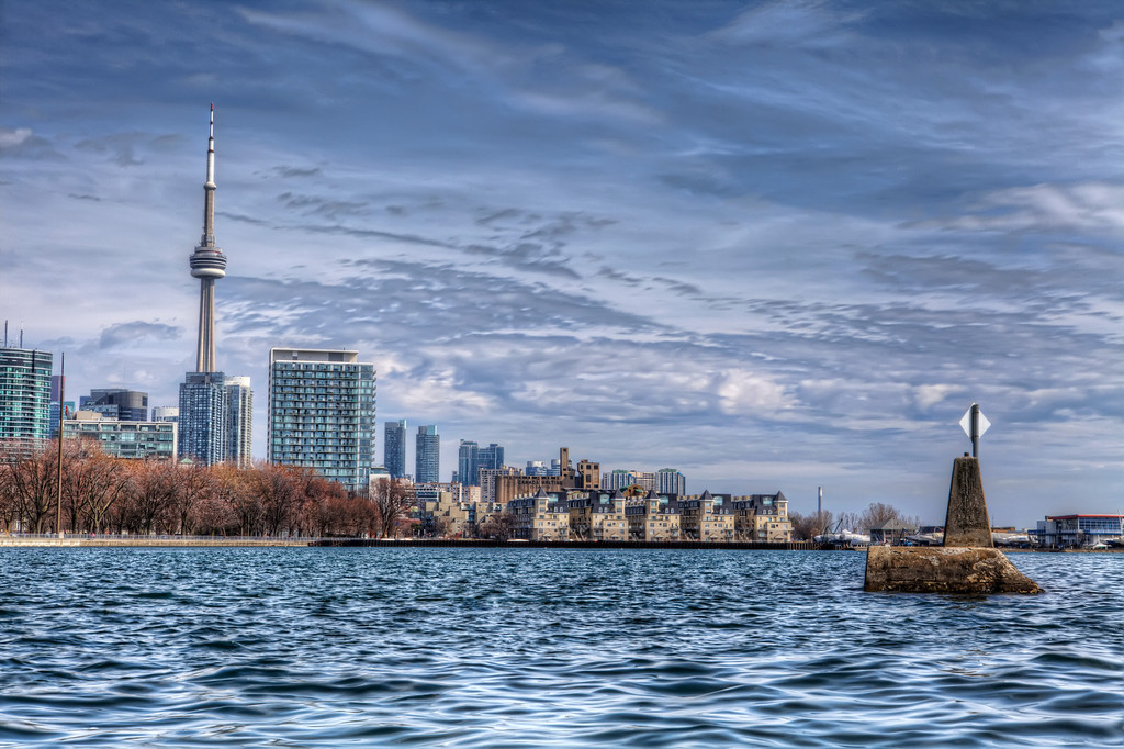 View of Toronto's skyline with the CN Tower prominent taken from the rocks near Ontario Place.