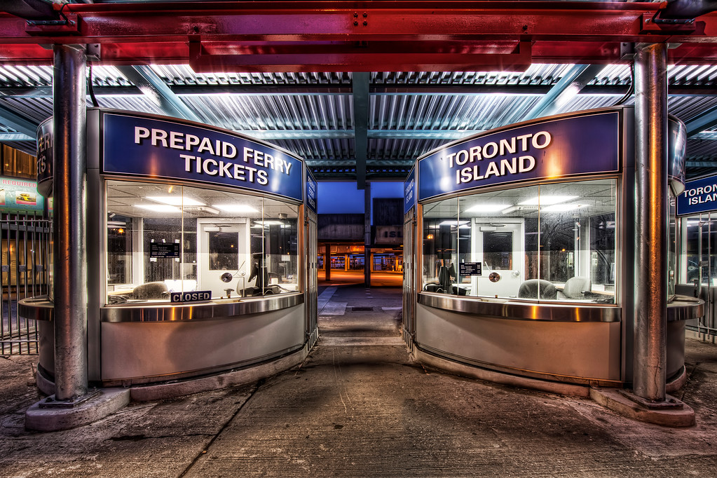 Bright colored ticket booths lit up at night for ferry to Toronto Island in Ontario