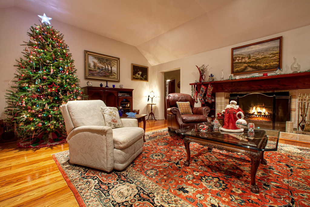 A living room decorated for Christmas with fire in fireplace in Bermuda