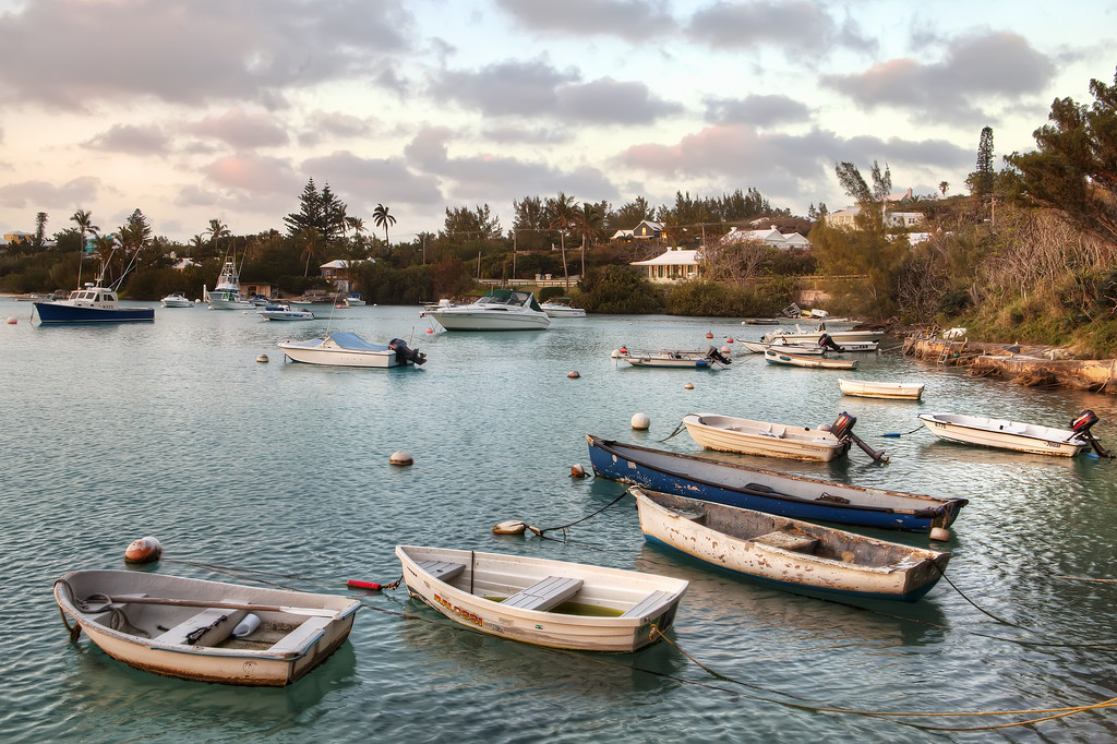 dinghies lined up near the shore in ely's harbour at sunset in Bermuda