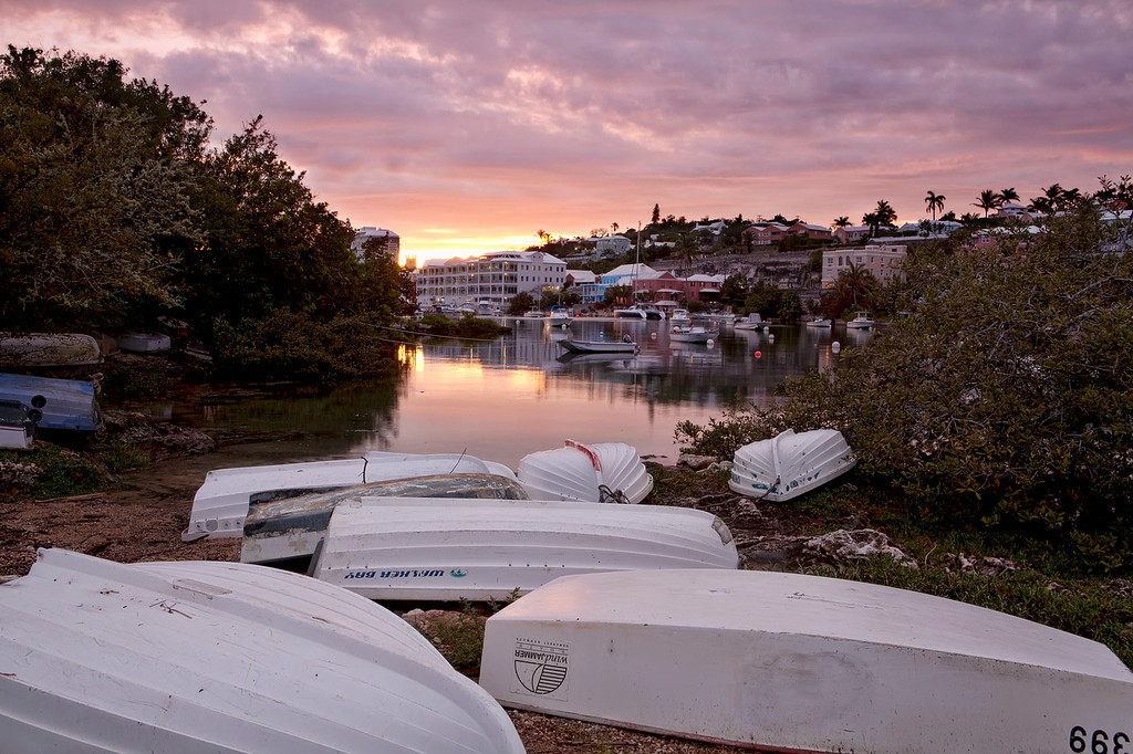 Dinghies on the shore in front of a beautful bermuda sunset