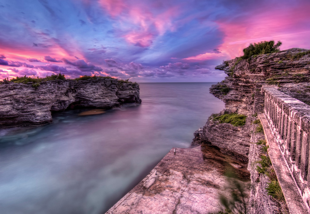 Dramatic blue, pink and purple sunset looking north over the ocean from Spanish Point, Bermuda