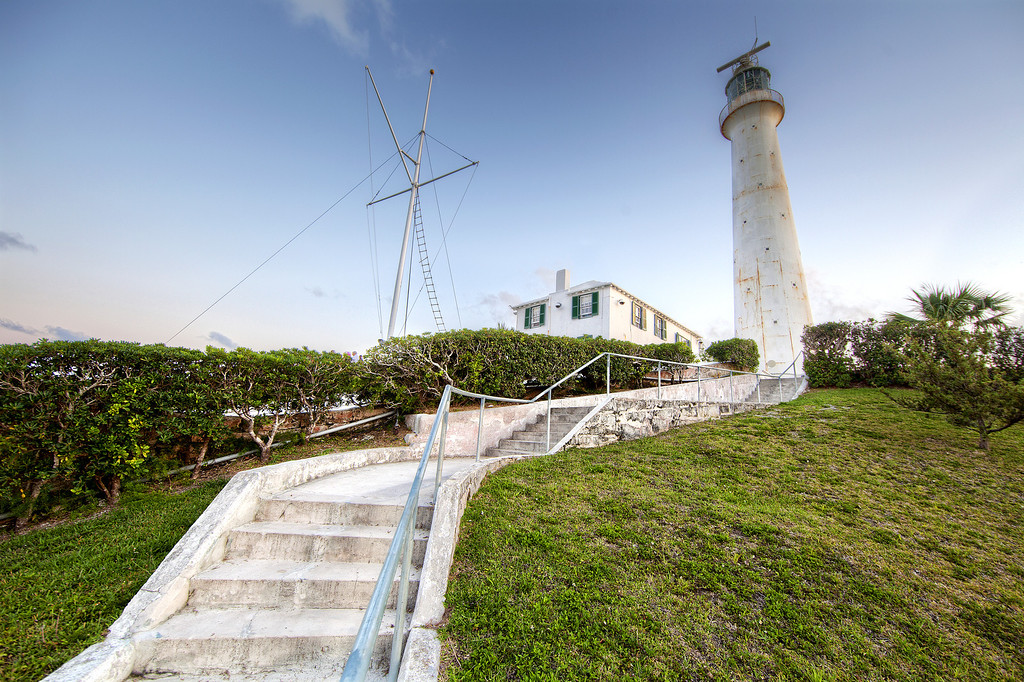 Gibbs Hill Lighthouse in Bermuda with stairs leading up to it in the foregound.