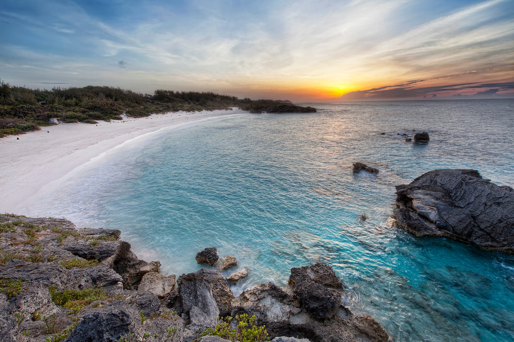 Sunrise over Horseshoe Bay beach Bermuda.