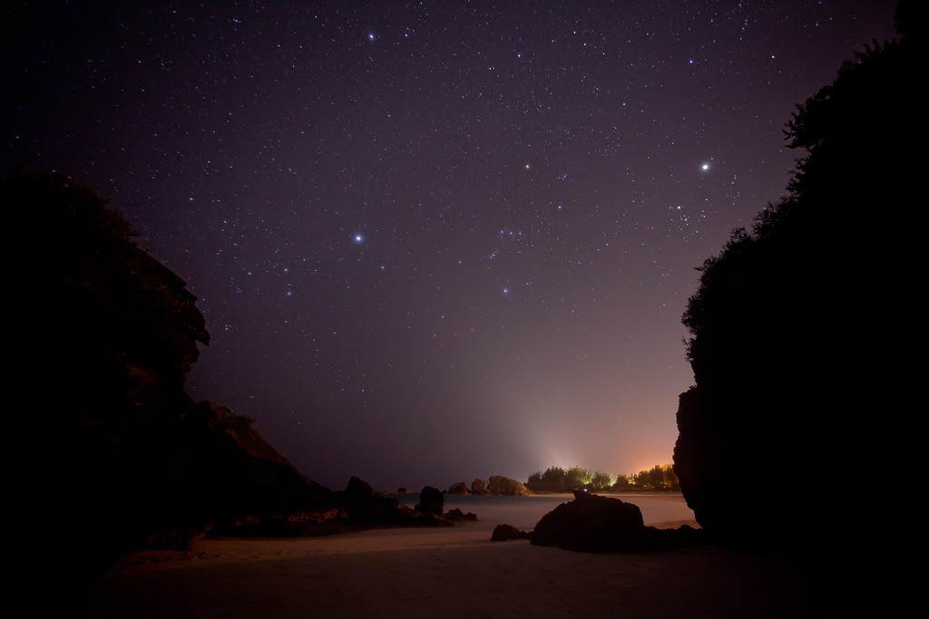 The starry night sky over Horseshoe Bay beach Bermuda