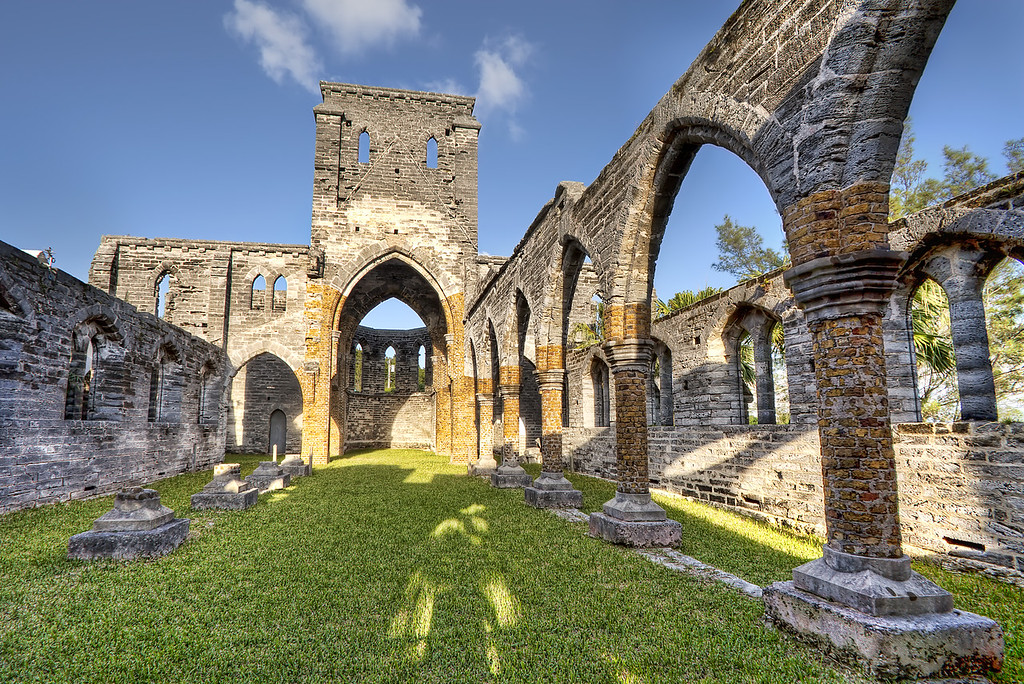 The interior archways of the unfinished church in Bermuda in front of a blue sky