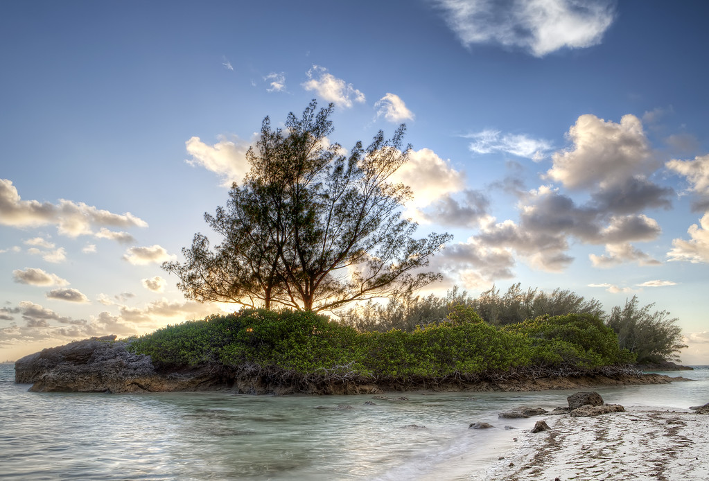 Police beach Bermuda at Sunset showing small island with trees