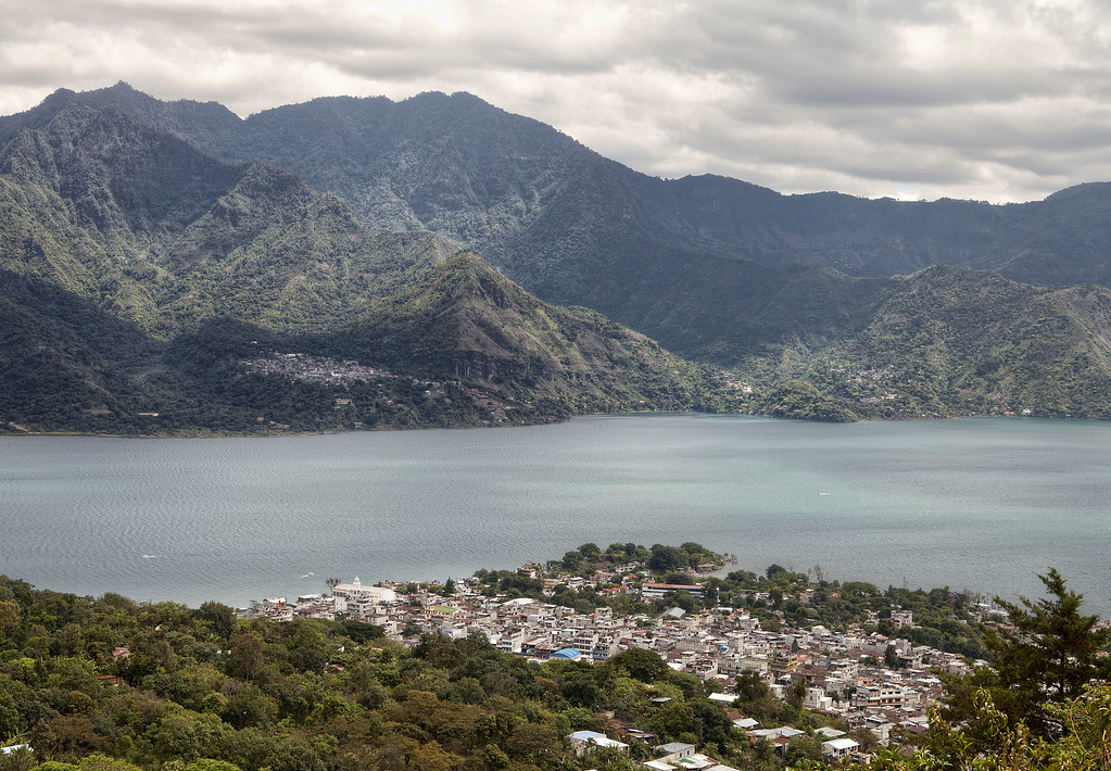 Panoramic view of San Pedro la Laguna and Lake Atitlan, Guatemala surrounded by moutains.