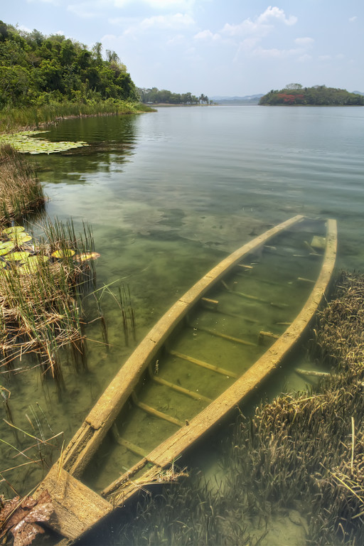 A sunken wooden boat on Lake Peten Itza, Flores, Guatemala