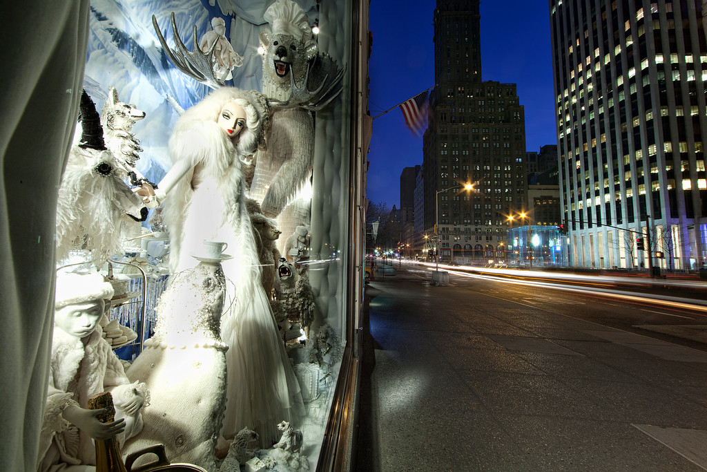 Bergdorf Goodman's 2011 Christmas window in white of woman, ram, bear and other animals with Fifth Avenue view looking uptown.