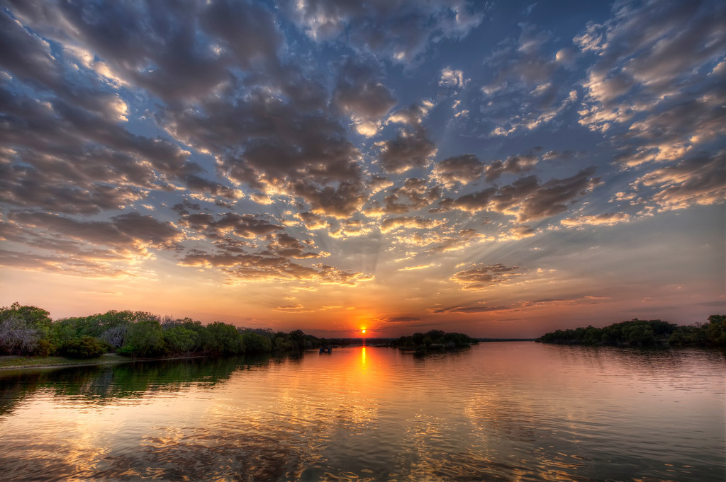 Glorious sunset over the Upper Zambezi River in Zambia with really majestic clouds.