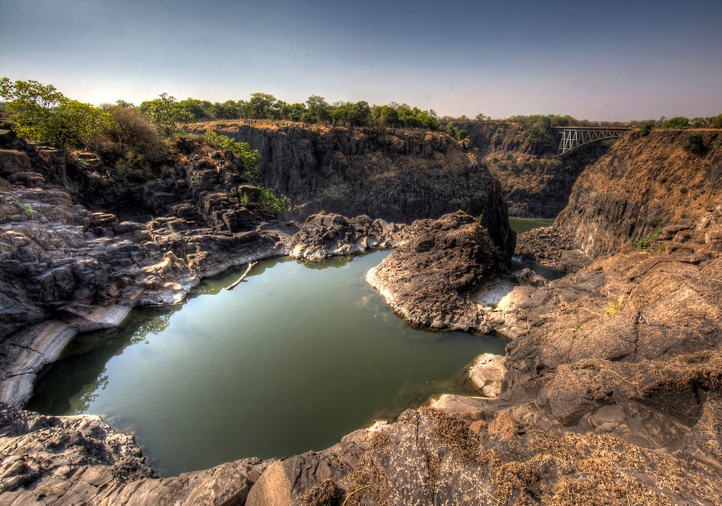 View of he Angel's Armchair on the way to Devils Hole at Victoria Falls showing a bridge used for bungee jumping.