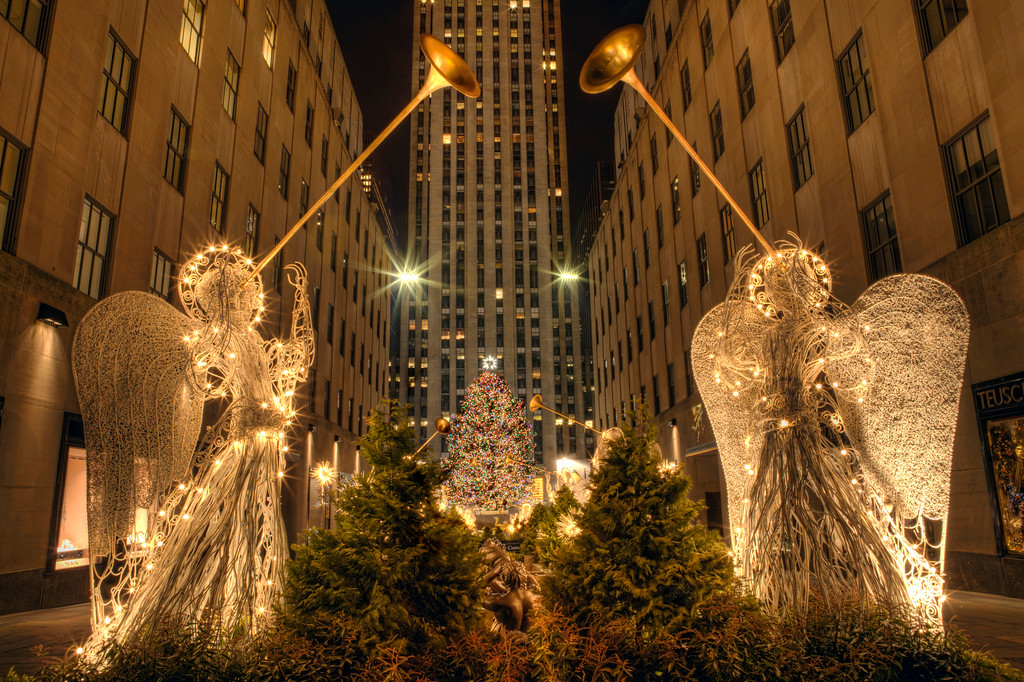 Night view of the lighted angels and Christmas tree at Rockefeller Center, New York City.