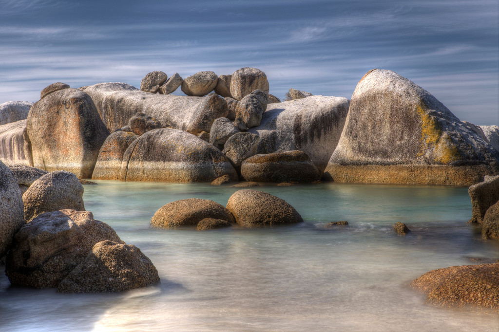 Ocean inlet in amongst piles of granite boulders in Boulders Bay, Simons Town, South Africa