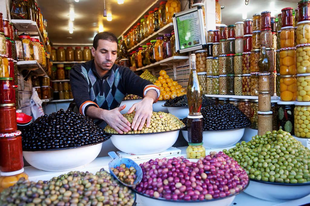 Moroccan-olive-seller-in-marrakech-market